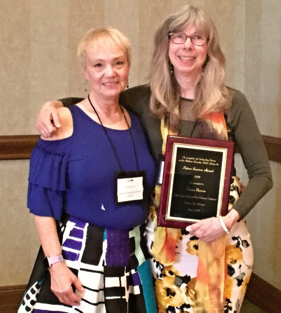 Jaema Berman (right), director of the Addison Township Public Library since 2011, with the Patron Services Award she received last week at the 2018 Loleta Fyan Small/Rural Libraries Conference. With her is Assistant Library Director Lyn Henderson, who spearheaded Berman's nomination. Photo provided.