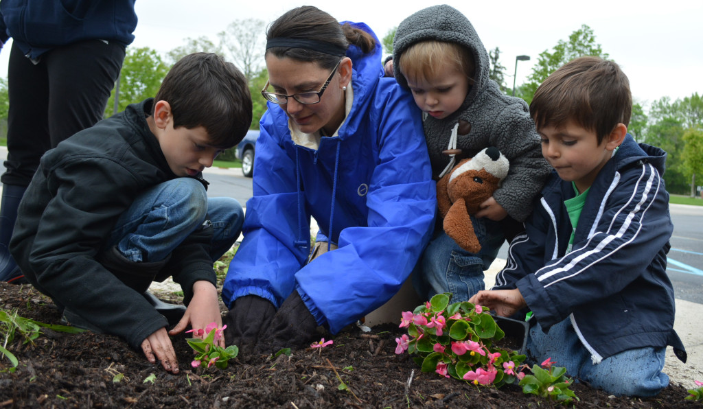 Planting flowers outside the Oxford Township Hall are (from left) Cub Scout Luca Bolognesi, Laura Bolognesi, Leo Bolognesi and Cub Scout GianMarco Bolognesi. Photo by C.J. Carnacchio.