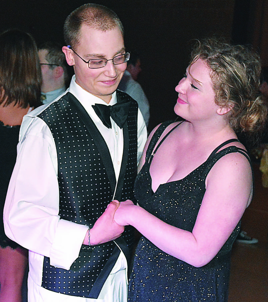 Noah Mathews, a special education student, shares a sweet moment while dancing with OHS student Aly Walters.  Photo by C.J. Carnacchio.