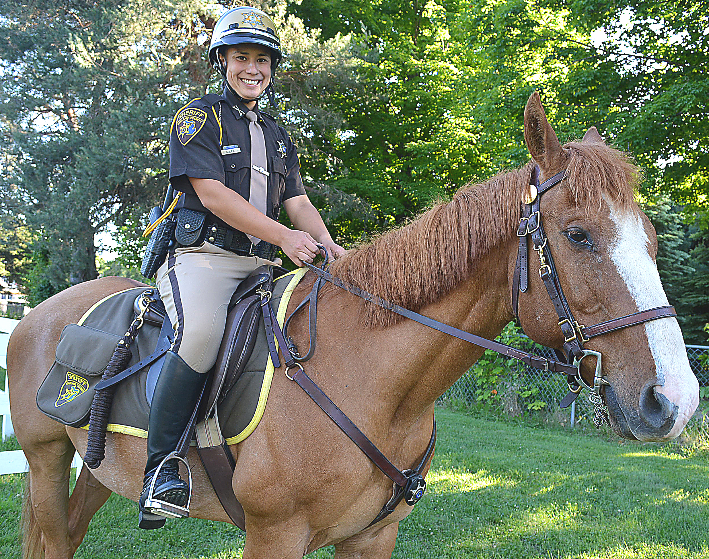 Look for Oakland County Sheriff's Mounted Deputy Stephanie Lee, of Lakeville, and her horse Hank Williams at county parks and special events this summer. Photo by CJC.