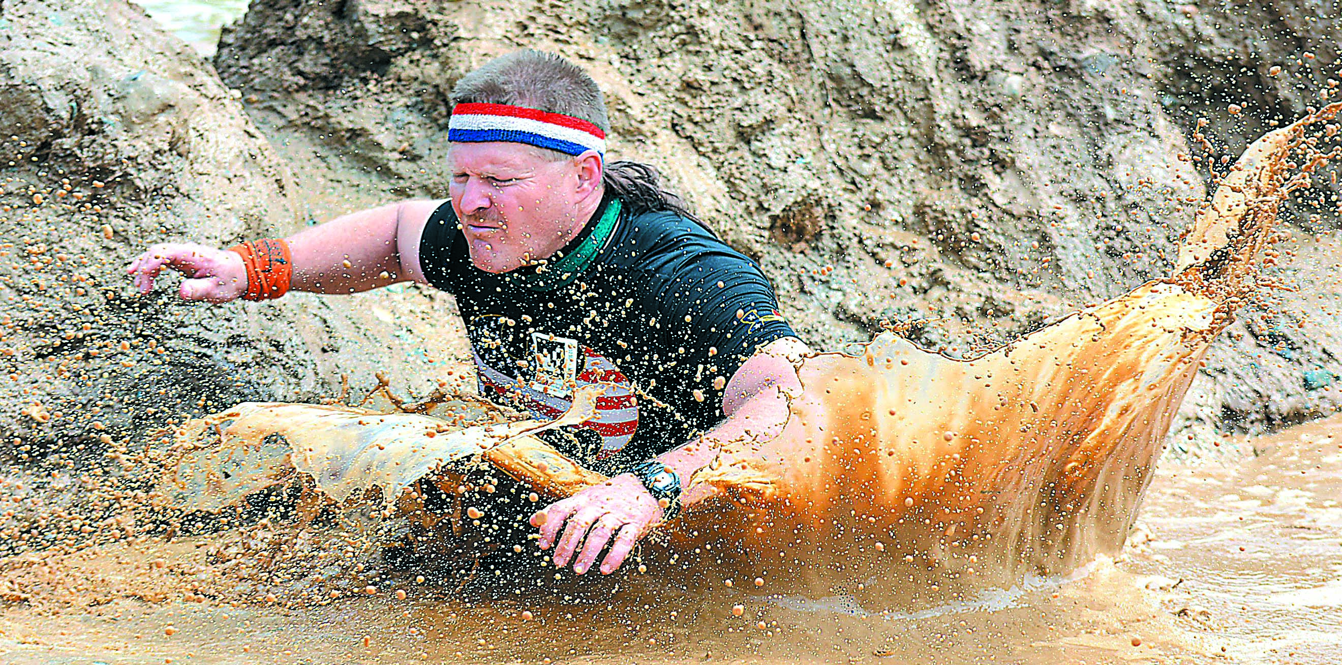 A total of 9,003 people got wet and muddy participating in the Tough Mudder event held June 2-3 on the 1,200-acre Koenig Sand & Gravel property in Oxford Township. For plenty of full-color Mudder photos, purchase a copy of the Leader for $1. Photos by C.J. Carnacchio.