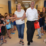 On Friday morning, Clear Lake Elementary students conducted a clap-out ceremony for retiring kindergarten teacher Diane Lukas-Noe, who's seen here walking arm-in-arm with her husband of 33 years, Mike Noe. She tried, but she just couldn't hold back the tears. Photos by C.J. Carnacchio.