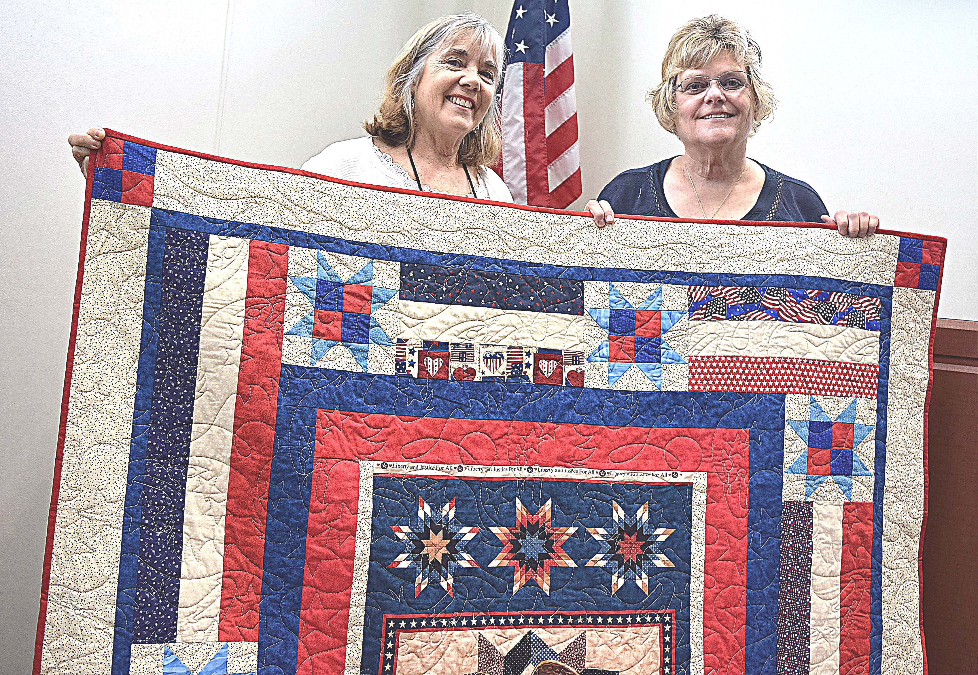 Jill Schoen (left) and Carole Carroll invite folks to attend Miracle Quilts' annual show and display June 9. Photo by Elise Shire.