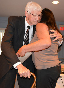 Joe Bullen hugs Councilwoman Maureen Helmuth, who created a resolution for him that praised his character, his leadership and his selfless commitment to Oxford Village. Photo by C.J. Carnacchio.