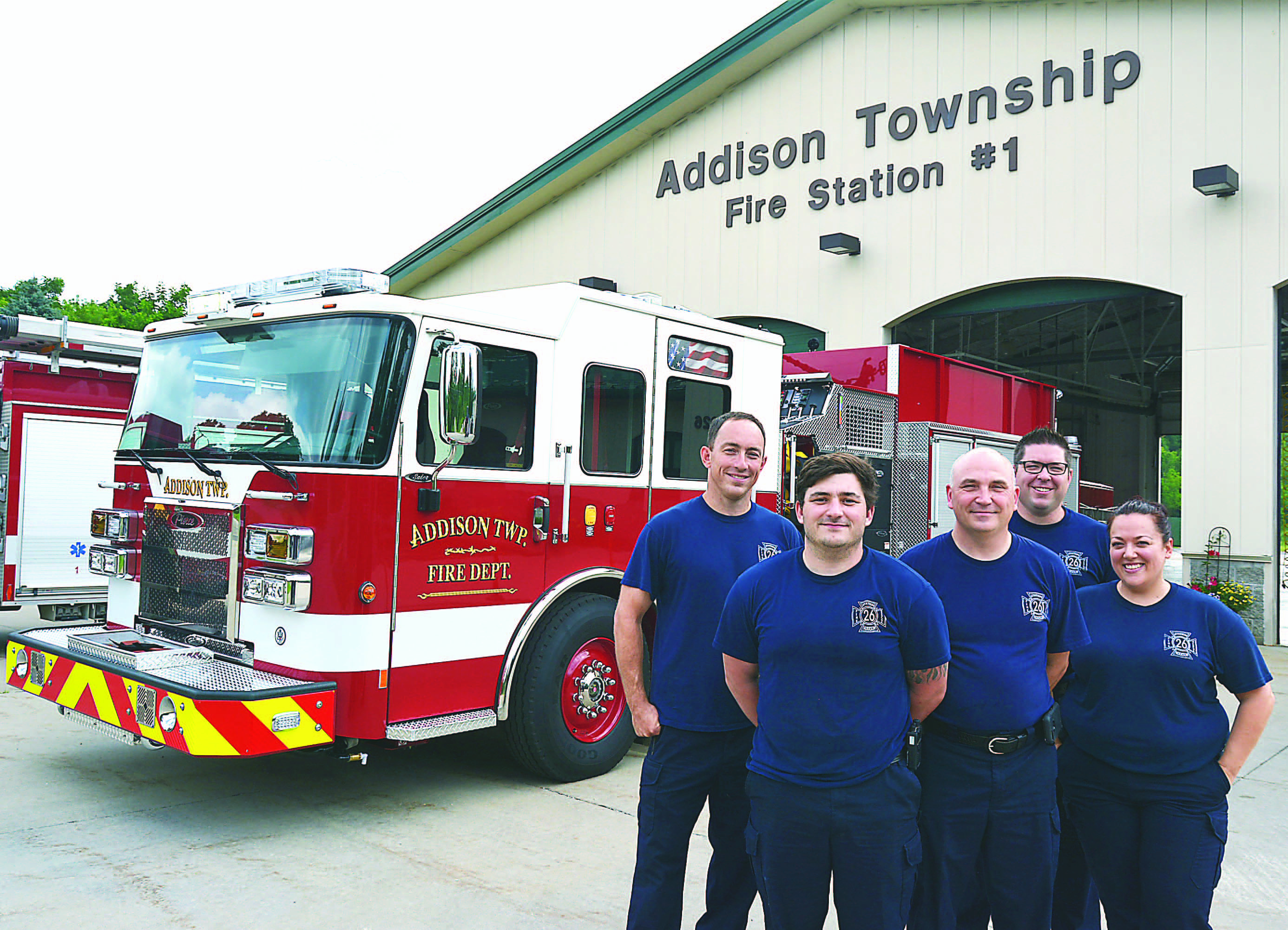Posing with the new engine are (from left) Lt. Dan Cline, Firefighter Tyler Hunsucker, Chief Jerry Morawski  and firefighters Rob Fitzpatrick  and Angela Logan. Photo by  C.J. Carnacchio.
