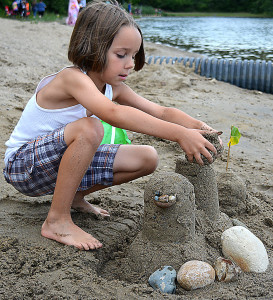 Oxford resident Maddock Henery, 8, builds a sandcastle on the beach at Stony Lake Twp. Park, one of four township parks that relies on the parks/rec. operating millage to keep it open and running. Photo by C.J. Carnacchio.