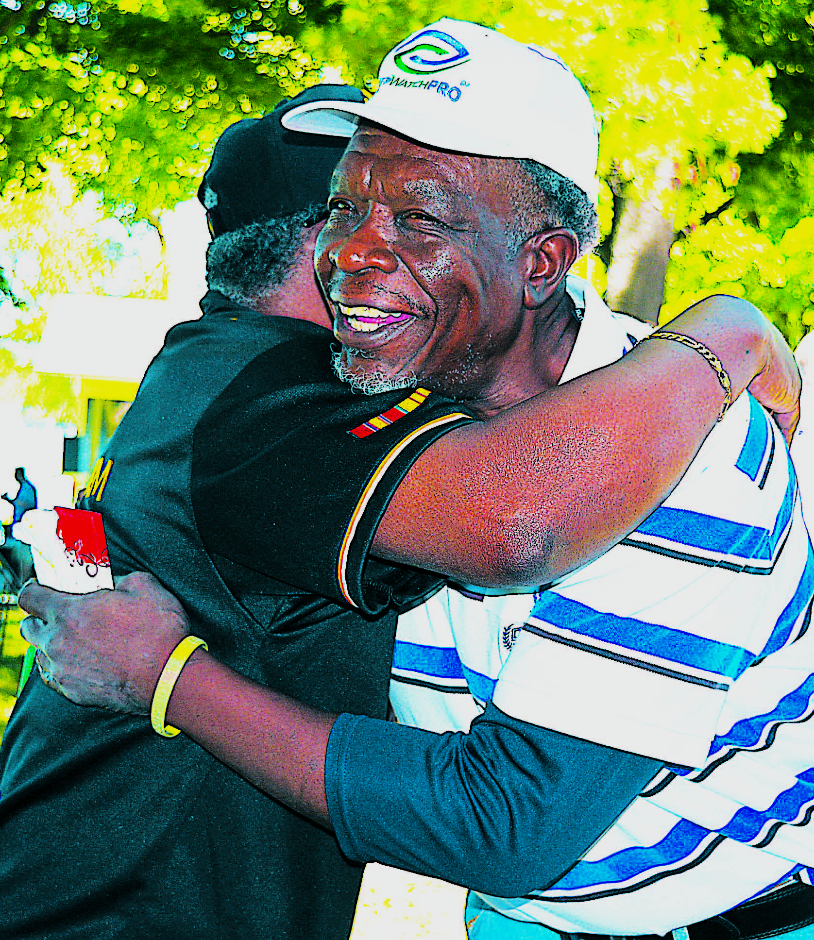 Receiving a big hug following a prayer is William Anthony, who served in the U.S. Air Force from 1975-80. Photo by C.J. Carnacchio.