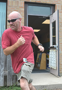 Brian Gohs, a custodian at Daniel Axford Elementary, practices the evacuation portion of ALICE training. Photo by C.J Carnacchio.