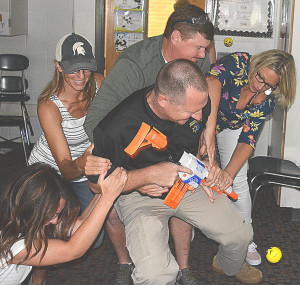 OES teachers prepare to defend themselves against an armed intruder by swarming Deputy Jason Louwaert. Photo by C.J. Carnacchio.