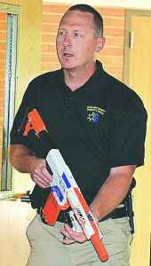 Armed with a Nerf gun, Oakland County Sheriff's Deputy Jason Louwaert pretended to be an attacker during ALICE training. Photo by C.J. Carnacchio.