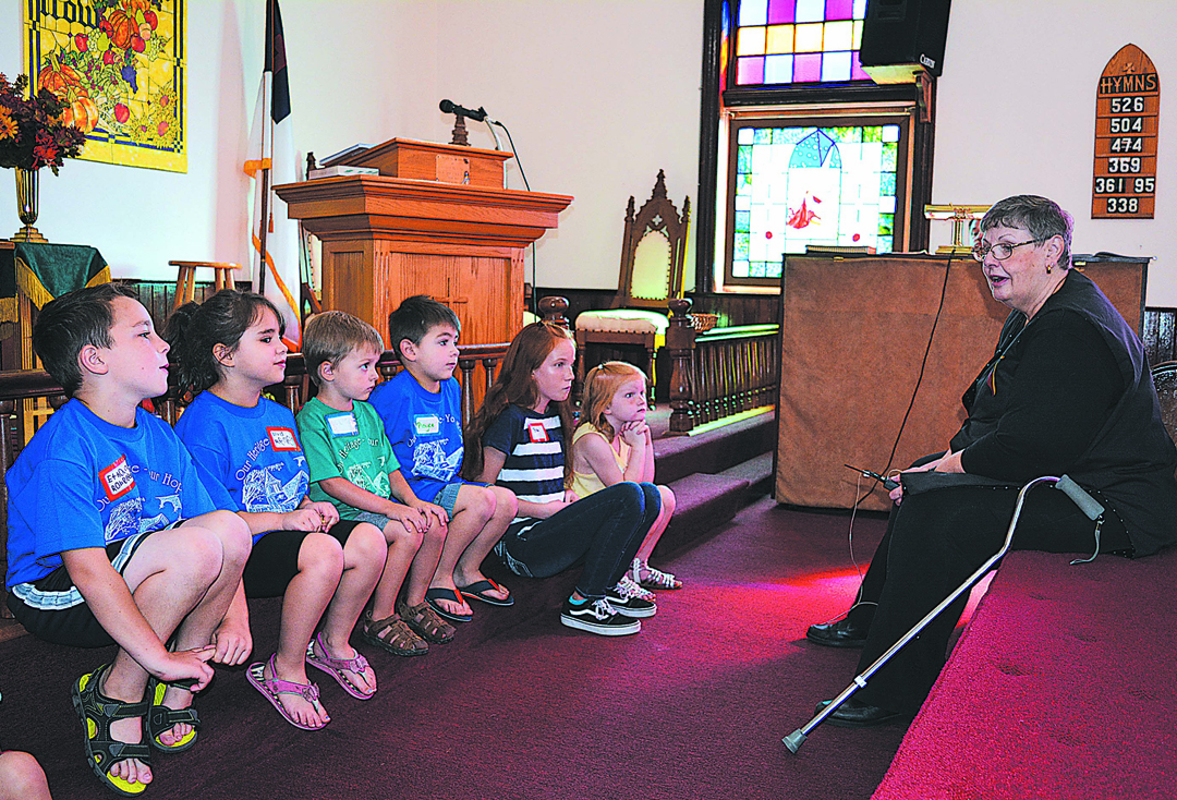 Rev. Carol Middel, pastor of Thomas United Methodist Church, addresses the children during the 125th anniversary service held Sunday morning. Photo by C.J. Carnacchio.