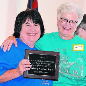 "Oxford-Orion FISH President Laurene Baldwin (right) presented Springfield Township resident Dawn Raffler, a member of Thomas UMC's leadership team, with a ""hospitality award"" to honor the church's years of support. Photo by C.J. Carnacchio."