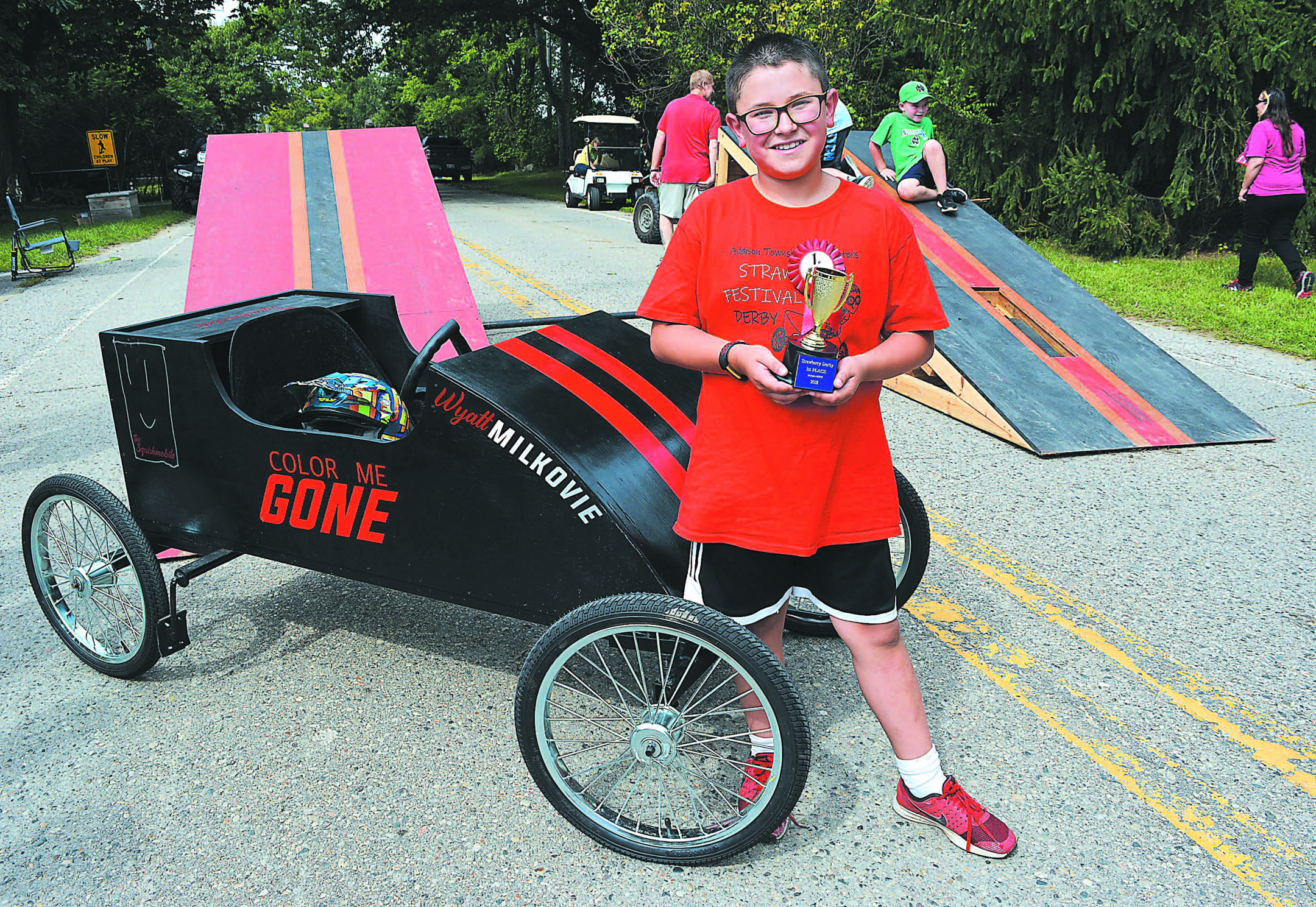 "Leonard Elementary fifth-grader Wyatt Milkovie won the Second Annual Strawberry Derby held Saturday morning in Leonard. He's shown above with his soapbox racer ""The Squishmobile."" Photo by C.J. Carnacchio."