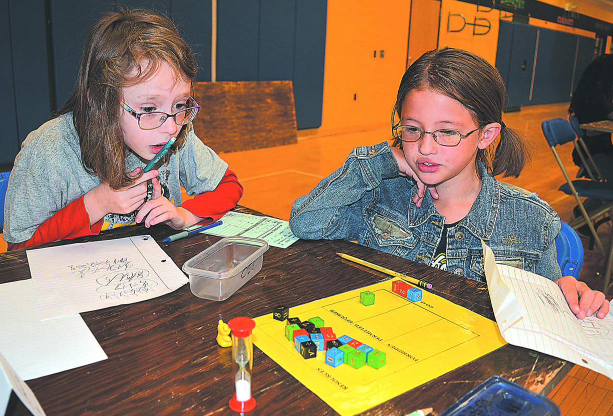 Contemplating their next moves are Sophia Schmalenberg (left), a third-grader at Clear Lake Elementary, and Celine Frank, a third-grader at Oxford Elementary. Photo by C.J. Carnacchio.