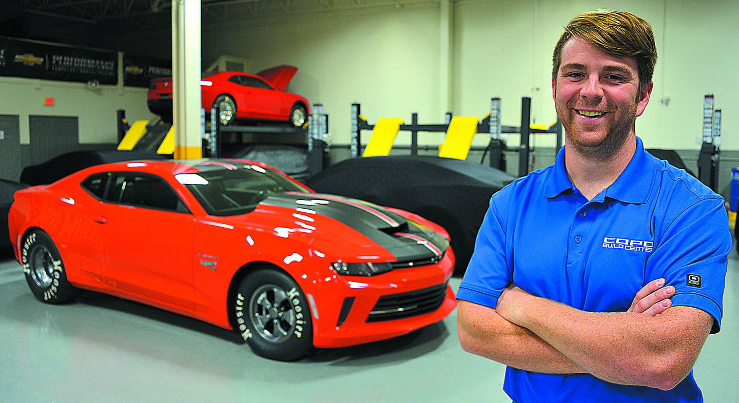 Mike Lawrence, a 2007 OHS graduate, is the operations manager at the COPO Build Center. Behind him is the 2018 COPO Camaro. Photo by C.J. Carnacchio.