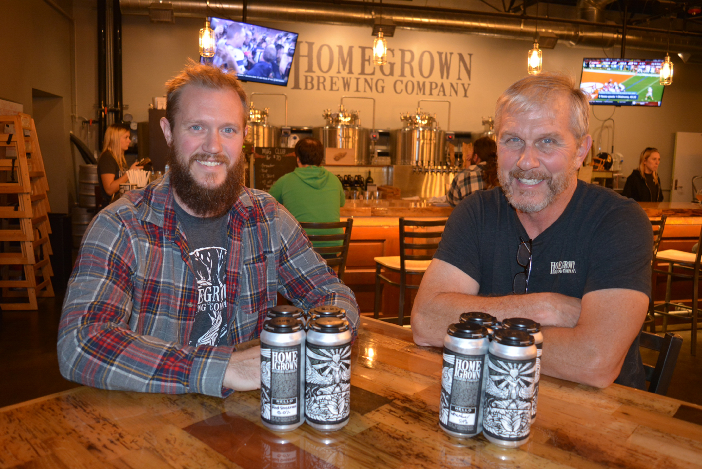 John Powers (right), co-owner of HomeGrown Brewing Company, and Head Brewer Joe Powers are excited to offer seven of their beers in four-packs of 16-ounce cans. Photo by C.J. Carnacchio.