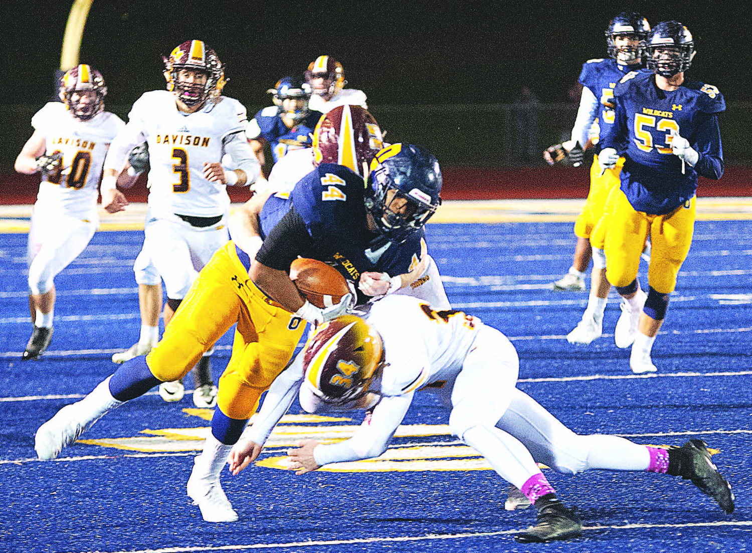 Oxford senior Marcus Hufnagel tries to evade a Davison defender. Photo by David Zanin.