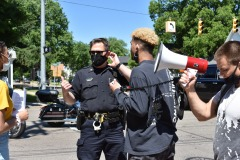 The-protest-organizer-Andrew-Jones-confers-with-Oxford-Police-Chief-Mike-Solwold-about-how-to-cross-the-intersection