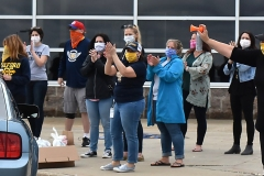 Masked teachers cheered.