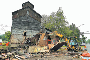 During one of the work days last summer, volunteers demolished the front portion of the old mill, which once housed the beanery.