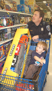 This is my favorite photo of Oxford Village Police Sgt. Mike Solwold. I snapped it during the Shop with a Hero event at Meijer in December 2011.