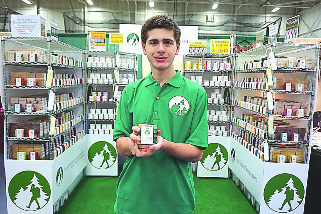 Spencer Kelly, 15, founder and owner of The Expedition Soap Co., is cleaning up selling his handcrafted, all-natural bars of soap, which come in 65 different varieties. He's a part-time student with the Oxford Virtual Academy. Photo provided.