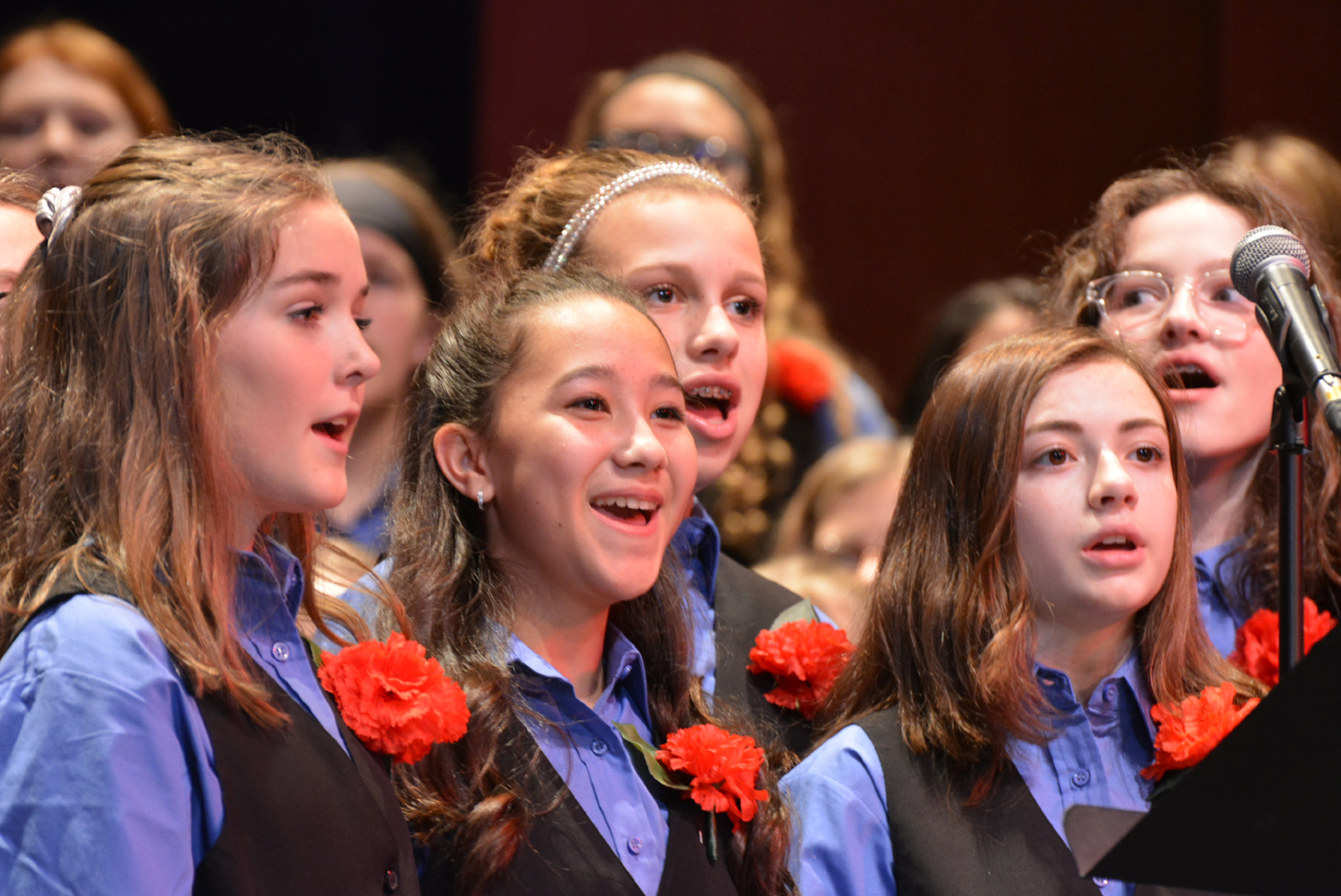 OMS choir students (from left) Savannah Feltrin, Serena Poynter, Layni Chaisson, Morgan McGuire and Sophia Ziegler sing as part of a Veterans Day tribute. For more photos, see Page 13. Photo by C.J. Carnacchio.