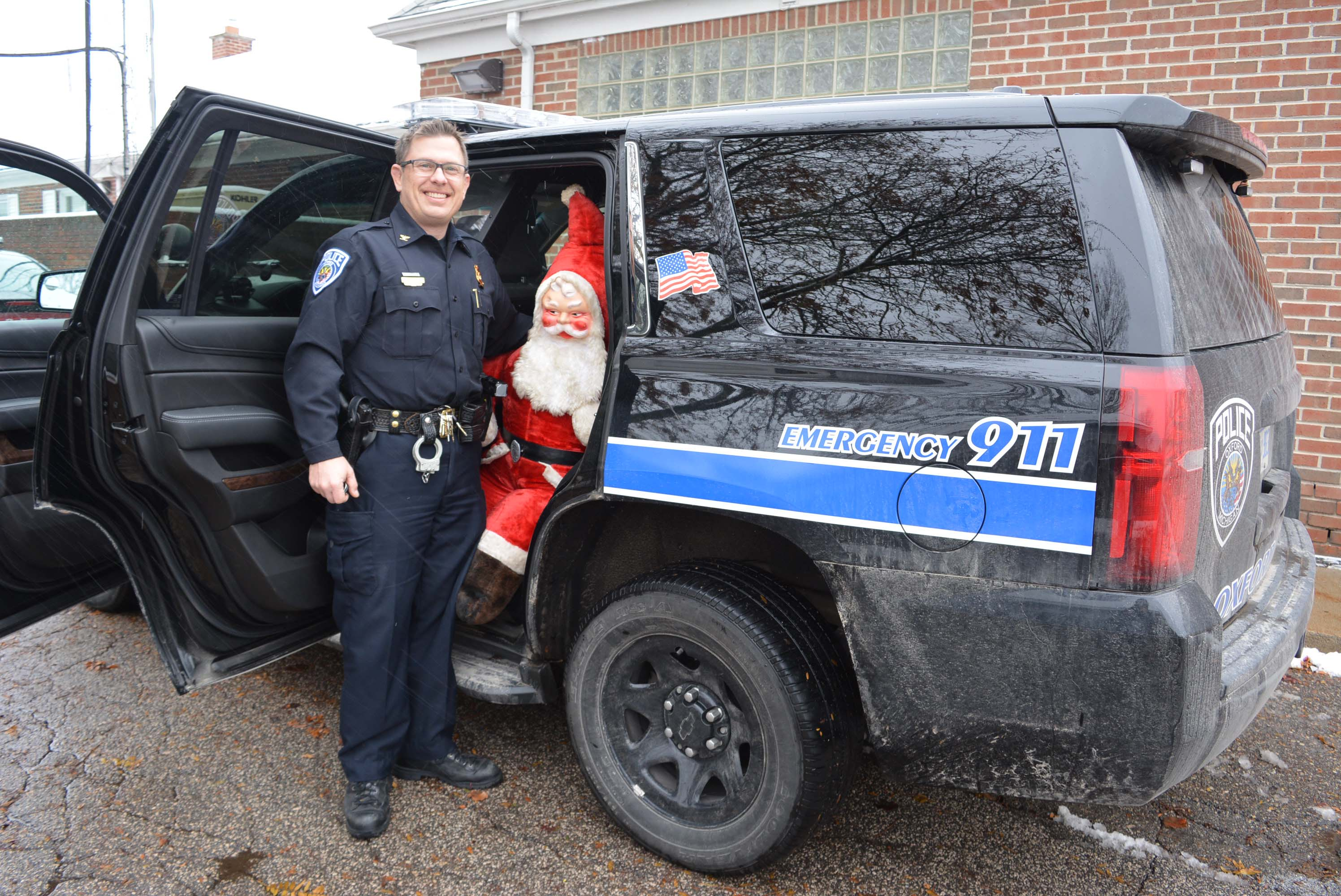 Oxford Village Police Chief Mike Solwold, a close personal friend of Santa Claus, is hoping to see his agency's Chevy Tahoe overflowing with toys on Saturday. Photo by C.J. Carnacchio.