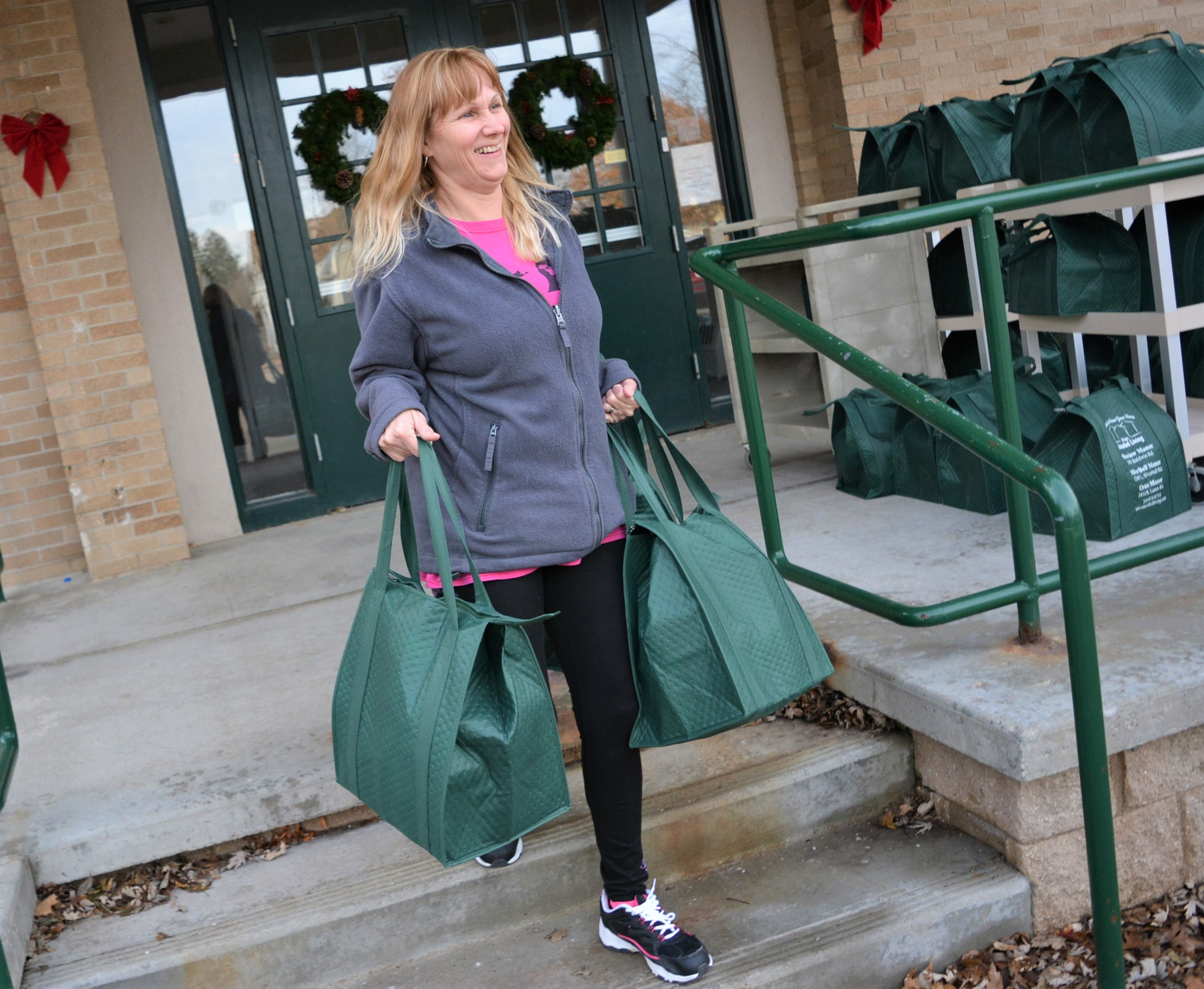 Meals on Wheels volunteer Christina Jeans, of Oxford, loads bags of food donated by North Oakland VFW Post 334 in preparation for delivering them to senior citizens on Dec. 19. Photo by C.J. Carnacchio.