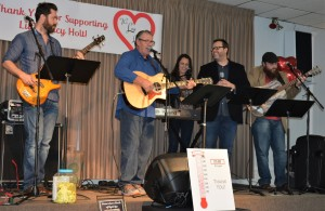 Performing during a November 2017 benefit concert for Lucy Holt are (from left) Bryan, Bob, Andrea, Jesse and Andrew Holt. The Holts will reunite Jan. 13 to rock the house at LakePoint Community Church in Oxford Township. Photo by C.J. Carnacchio.