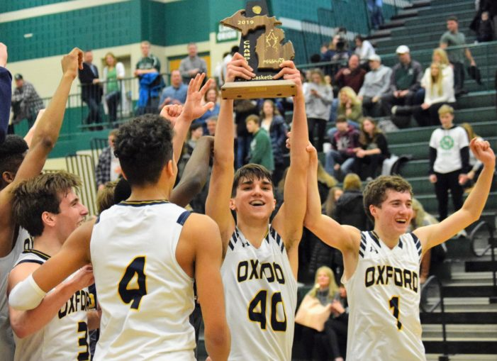 Cats slay Dragons to win district title