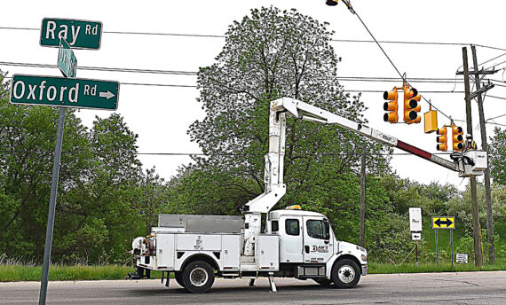 Traffic signals go up, stop signs come down along M-24