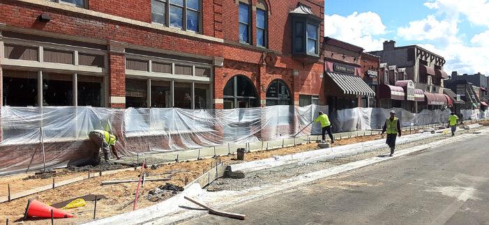 New sidewalks downtown, M-24 project behind schedule