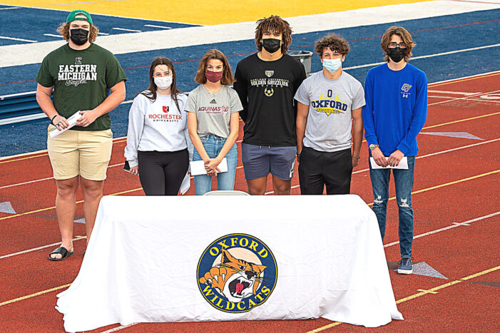 Six Wildcats sign to compete collegiately