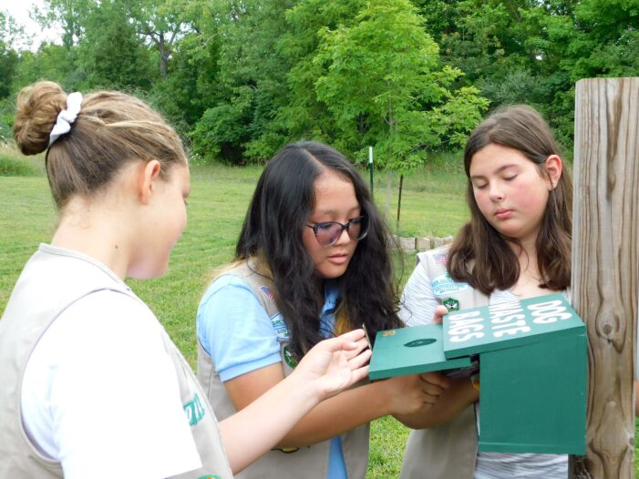 Girl Scouts build waste boxes for Polly Ann Trail
